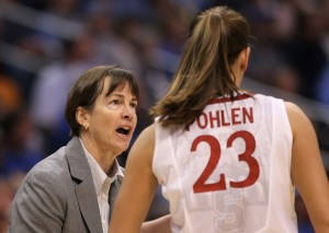 Stanford Basketball Coach Tara VanDerveer talks to a player during a game.