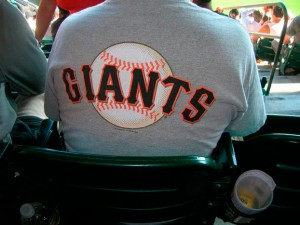 A fan wears a San Francisco Giants t-shirt.