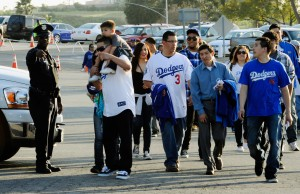 LAPD watch as Dodger fans enter Dodger stadium.