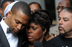Wanda Johnson, the mother of Oscar J. Grant III, was comforted by her supporters outside the Los Angeles Superior Court after Johannes Mesherle was sentanced to voluntary manslaughter.  Mark Ralston/AFP/Getty