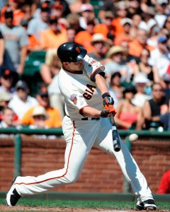 Pat Burrell of the San Francisco Giants hits a single against the Colorado Rockies.