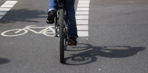 A cyclist pedals along a dedicated bike lane.
