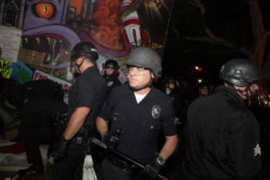 Police officers entered the plaza in riot gear and carrying billy clubs. photo by Grant Slater/KPCC
