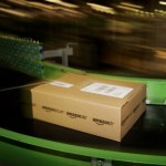 An Amazon parcel passes along a conveyor belt. (Bruno Vincent/Getty Images)