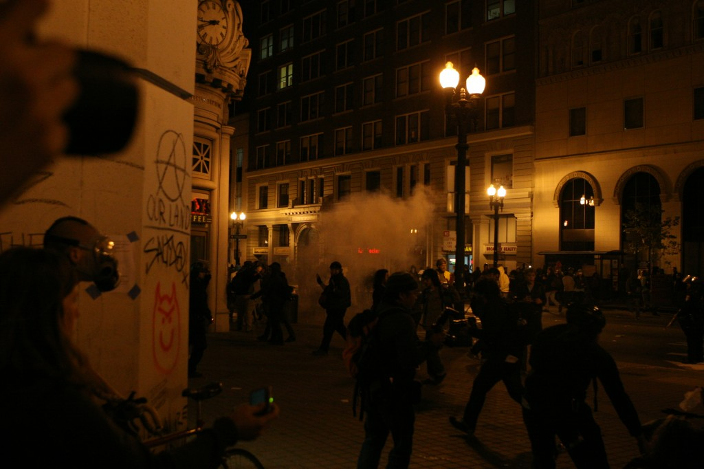 An explosive device detonates after police rush protesters at 14th and Broadway.
