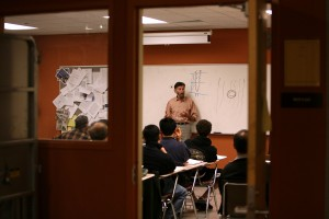 Students learn about solar panel installation in a class at San Francisco City College. (Justin Sullivan/Getty Images)