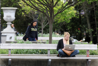 A UC Berkeley student works on her laptop on campus. (Justin Sullivan/Getty Images)