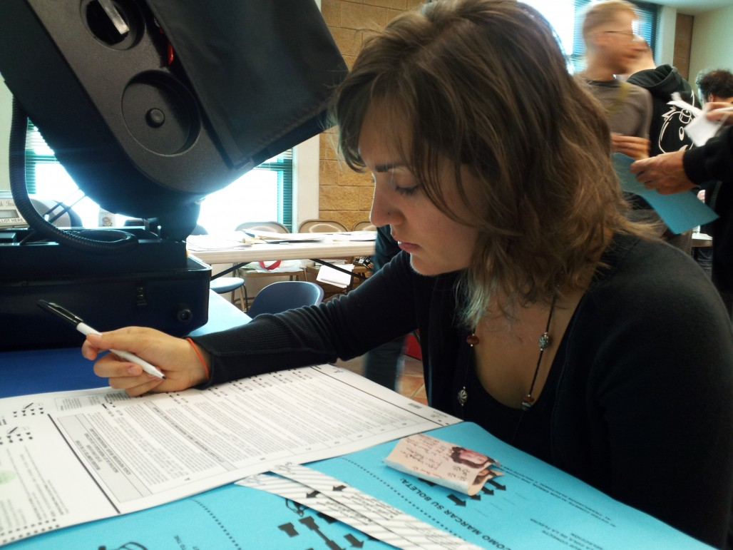A voter scans her ballot in San Francisco on Nov. 6, 2012. (Aarti Shahani/KQED)