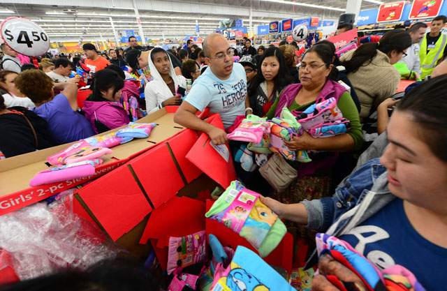 People get an early start on Black Friday shopping Thursday at a Walmart Superstore in Rosemead, near Los Angeles. Photo by FREDERIC J. BROWN/AFP/Getty Images.