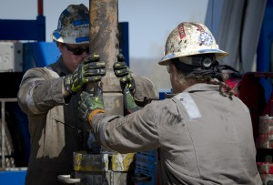 Workers change the pipes in a fracking operation in Waynesburg, PA. (Mladen Antonov/AFP/Getty Images)