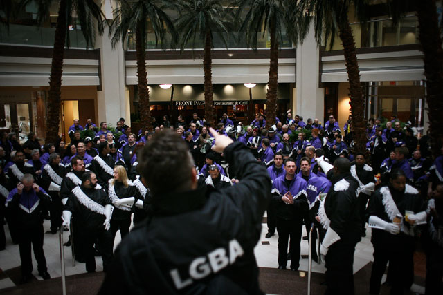 Members of the Lesbian and Gay Band Association prepare for the Inaugural Parade. (James Tensuan/NewsHour)