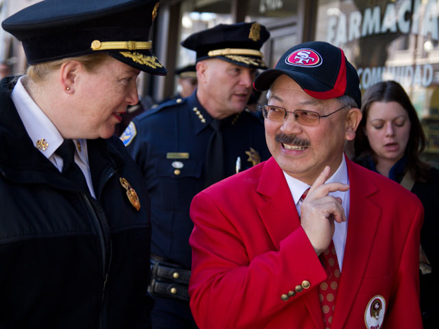 Fire Chief Joanne Hayes White walks with Mayor Ed Lee as they visit merchants in the Mission District neighborhood to highlight the cities efforts to respond to the outcome of the 49ers game on Sunday. (Deborah Svoboda/KQED)