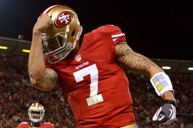 "The creation of ""Kaepernicking."" San Francisco 49ers QB Colin Kaepernick flexes in the end zone during his team's playoff win over the Green Bay Packers. Photo by Harry How/Getty Images."