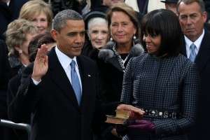 Barack Obama is sworn in during the public ceremony as First lady Michelle Obama looks on (Alex Wong/Getty Images)
