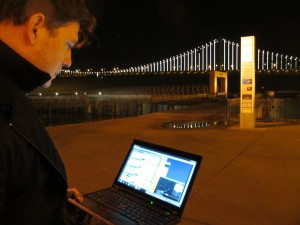 Artist Leo Villareal controls the Bay Lights with his laptop. (Cy Musiker/KQED)