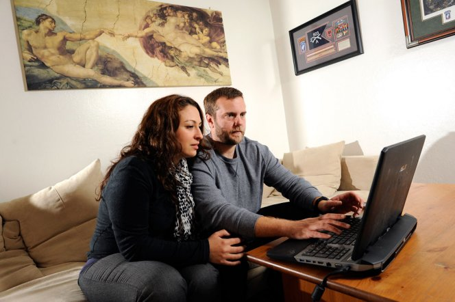 Army vet Michael Grabski and his wife, Sandra, search real estate websites in their Napa apartment. The Department of Veterans Affairs expedited Grabski's 2-year-old claim for post-traumatic stress disorder and a knee injury after his case received media attention. (Michael Short/Center for Investigative Reporting)