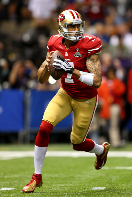 Colin Kaepernick in the first quarter. (Mike Ehrmann/Getty Images)