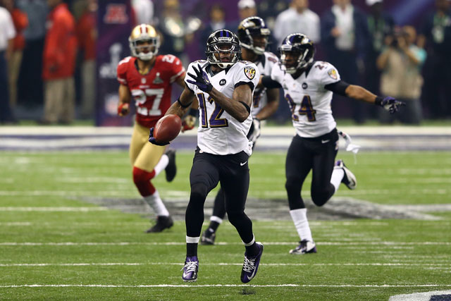 Jacoby Jones runs back a record 109-yard kickoff return for a touchdown in the third quarter. (Al Bello/Getty Images)