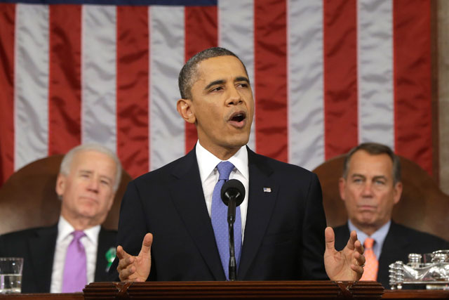 President Barack Obama, flanked by Vice President Joe Biden and House Speaker John Boehner, gives the State of the Union address. (Charles Dharapak-Pool/Getty Images