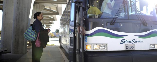 A rider waits to board the Solano Express in Fairfield. (Michael Short/The Bay Citizen)