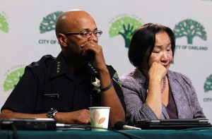Oakland police chief Howard Jordan (L) and Oakland Mayor Jean Quan pause during a press conference about Occupy Oakland in 2011, a low point in Quan's approval ratings.  Oakland Mayor Jean Quan held a press conference to address police action taken on Occupy protesters who staged a demonstration in downtown Oakland. (Photo by Justin Sullivan/Getty Images)