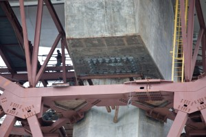 A view of the underside of the eastern side of the new Bay bridge on March 27. Steel rods on the new eastern span of the Oakland-San Francisco Bay bridge, snapped when workers were tightening the fittings. (Deborah Svoboda/KQED)
