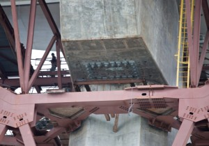 A view of the underside of the eastern side of the new Bay Bridge on March 27. Bolts can be seen in a rectangular formation in the center of the photo. Thirty-two steel rods on the new eastern span have snapped. (Deborah Svoboda/KQED)