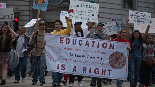 Students marched from several San Francisco city college campuses, to Mission High school to ask students to join them on their march to city hall, where they held a rally of several hundred people. (Deborah Svoboda/KQED)