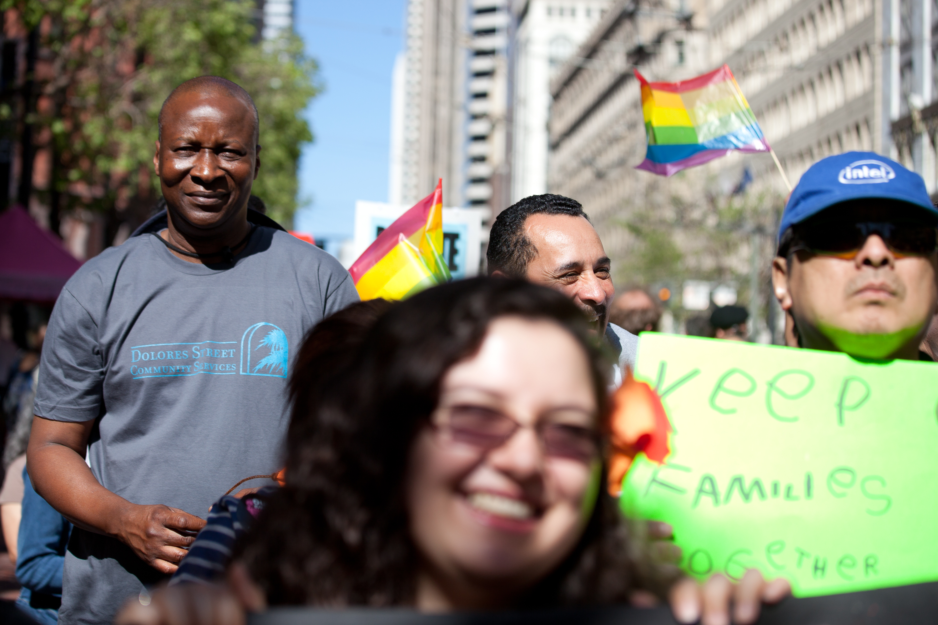 Adoubou Traore (left) marches with about 1,000 people in San Francisco on a national day of action, to support a comprehensive immigration reform that includes a path to citizenship. (Deborah Svoboda/KQED)