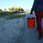 Reporter Katharine Mieszkowski carries buckets containing carefully separated soil samples from Treasure Island, which later were tested at two independent certified radiation labs.(Kerri Connolly/Center for Investigative Reporting)