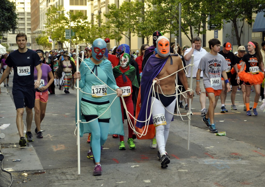 Runners dressed in lucha libre costumes (Lauren Benichou/KQED)
