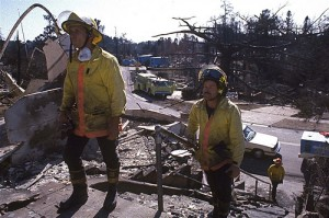 Firefighters overlook the damaged structures after the Oakland Hills fire burned dozens of neighborhoods and thousands of homes. (Credit: CalEMA)