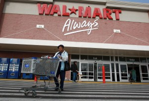 File photo. A customer leaves a Wal-Mart store in Oakland, California. (Justin Sullivan/Getty Images)