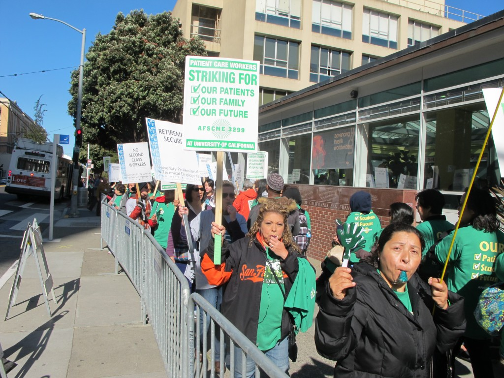 Striking workers whistled on the picket line at UC San Francisco. (Andrew Stelzer/KQED)