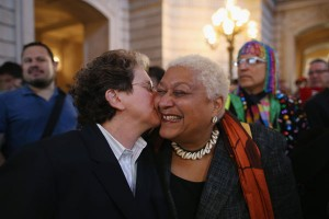 A couple celebrates at San Francisco City Hall upon hearing the U.S. Supreme Court has struck down the Defense of Marriage Act on June 26, 2013. (Photo by Justin Sullivan/Getty Images)