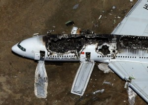 Asiana Airlines Flight 214 lies burned on the runway after it landed at San Francisco International Airport. (Ezra Shaw/Getty Images)