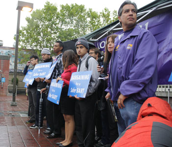 Saul Almanza, BART track safety trainer and SEIU 1021 vice president of BART professional chapter, stands at a June 25 rally at 24th and Mission streets in San Francisco calling attention to safety issues the union says are plaguing the BART system.