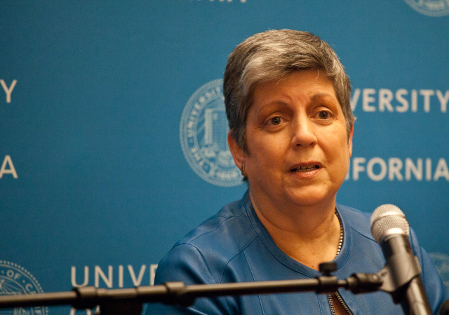 Janet Napolitano speaks to the press in July as students protest her selection as president outside. (Photo by Deborah Svoboda/KQED)