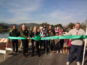 The Ross Valley Sanitary District in happier times, celebrating the opening of the Corte Madera path and completion of the replacement of a large main pipe. At the front, cutting the ribbon, can be seen former sanitary district manager Brett Richards and former board member Marcia Johnson. Photo: RVSD Courtesy press photo