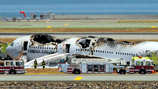 A Boeing 777 airplane lies burned on the runway after it crash landed at San Francisco International Airport July 6, 2013 in San Francisco, California. An Asiana Airlines passenger aircraft coming from Seoul, South Korea crashed while landing. There has been no official confirmation of casualties. (Photo by Ezra Shaw/Getty Images)