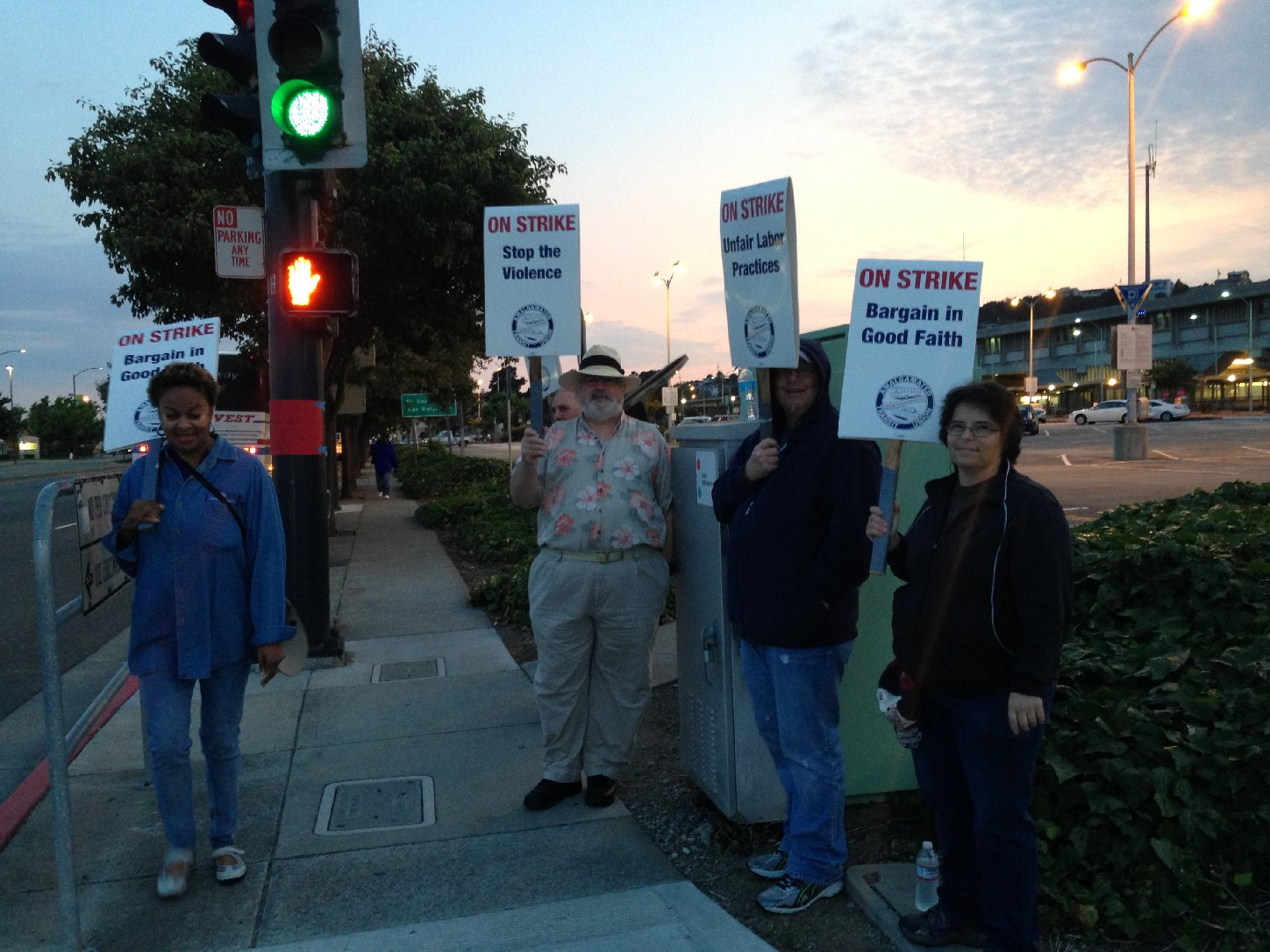 Picketers at del Norte Station. (Isabel Angell/KQED)
