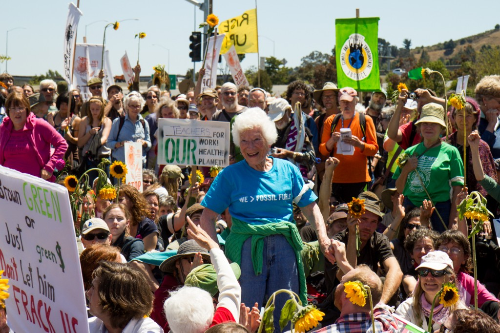 Ellen Small, 90, a retired nurse from Oakland, gets ready to be arrested during Aug. 3, 2013, protest at Chevron's refinery complex in Richmond. She was one of 210 people arrested. (John Orvis/johnorvis.com)