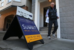 A sign is posted in front of a home for sale during an open house. Increasing inventory could slowdown rising asking prices. (Justin Sullivan/Getty Images)