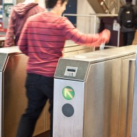 BART passenger enters fare gates.