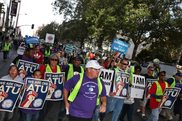 About 400 BART workers and union supporters gathered in Oakland at Frank Ogawa Plaza in August 2013 to rally in support of better wages for BART workers. (Deborah Svoboda/KQED)