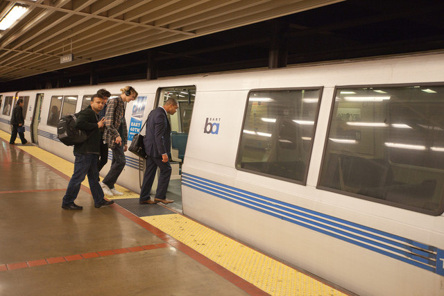 On the first night of the Bay Bridge closure, BART runs trains all night. About a dozen people wait in MacArthur BART station to take the 1:28 am train to San Francisco. Photo by (Deborah Svoboda / KQED)