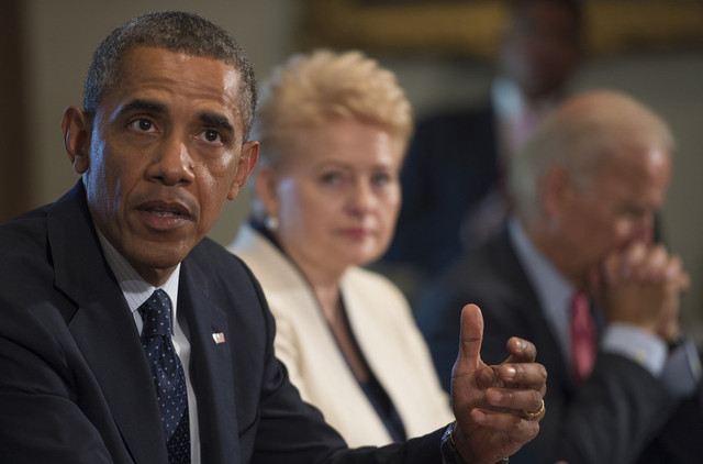 Pres. Barack Obama delivers a statement on Syria during a meeting with Lithuania's Pres. Dalia Grybauskaite (center) and Vice Pres. Joe Biden at the White House in Washington, DC on August 30, 2013. (Jim Watson/AFP/Getty Images)