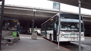 An AC Transit bus waits at Macarthur BART station in Oakland. (Deborah Svoboda/KQED)