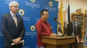 Victim's son, Terry Hui, with San Francisco District Attorney George Gascon and Deputy DA Omid Talai. (Bryan Goebel/KQED)