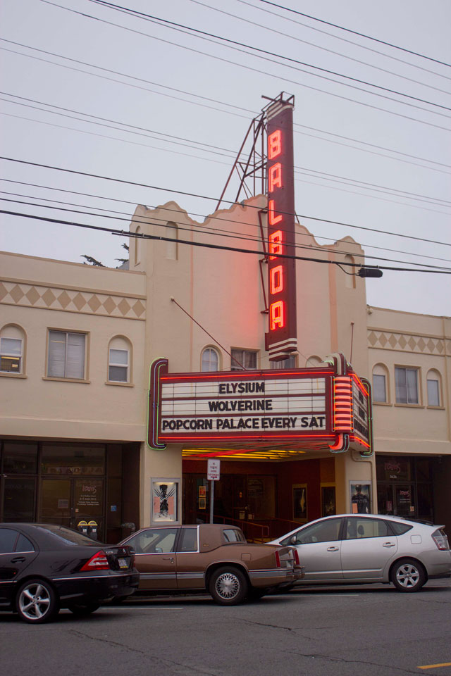 The Balboa Theatre's glowing lights illuminate the street from blocks away, but operators say the theater could go dark if it can't pay to install digital projection equipment. (Victor Casillas Valle/Ocean Beach Bulletin)
